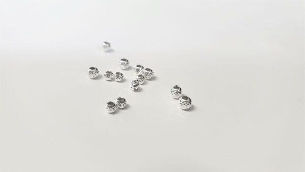 Silverpärlor, facett